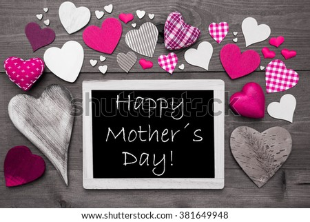 Chalkboard With English Text Happy Mothers Day . Many Pink Textile Hearts. Wooden Background With Vintage, Rustic Or Retro Style. Black And White Image With Colored Hot Spots. - stock photo