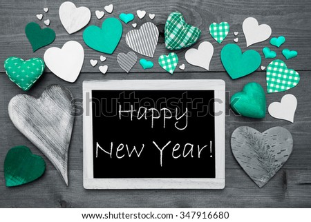 Chalkboard With English Text Happy New Year. Many Green Textile Hearts. Wooden Background With Vintage, Rustic Or Retro Style. Black And White Image With Colored Hot Spots. - stock photo