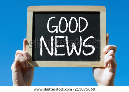 Chalkboard with Hands with text good news - stock photo