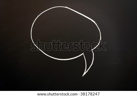 chalkboard with speech bubble  and copyspace for text message - stock photo