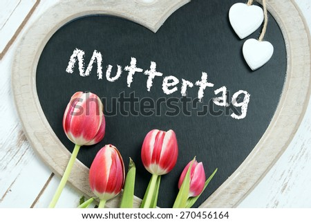 Chalkboard with the german word Mothers Day / Mothers Day - stock photo