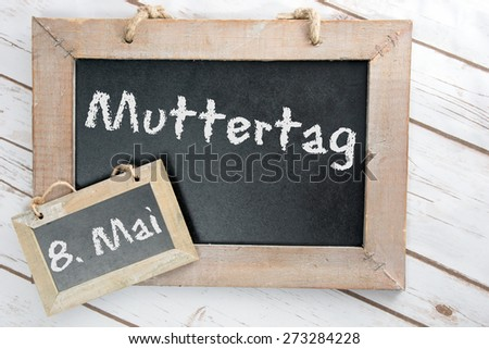 Chalkboard with the german words Mother Day / Mother Day - stock photo