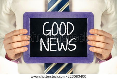 Chalkboard with with text good news. Man holding Chalkboard with with text good news  - stock photo