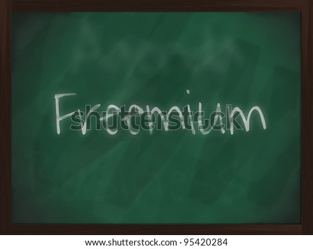 Chalkboard with wooden frame and the text freemium - stock photo