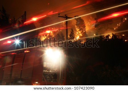 CHALKIDIKI, GREECE - AUGUST, 21 : Firefighters fight a forest fire 21 August 2006 ripping through the Halkidiki Peninsula in northern Greece