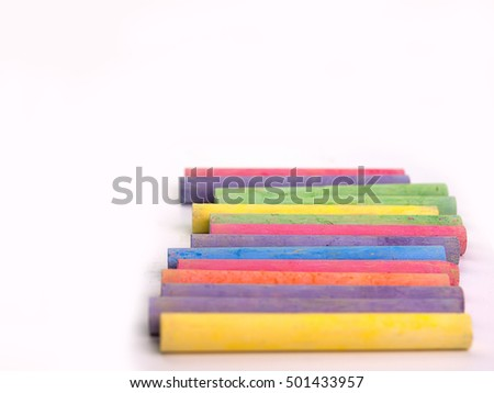 chalks in a variety of colors , Placed on a white background. (Space for placing text)