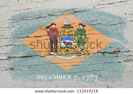 Chalky american state of delaware flag precisely painted with color chalk on grunge wooden texture - stock photo