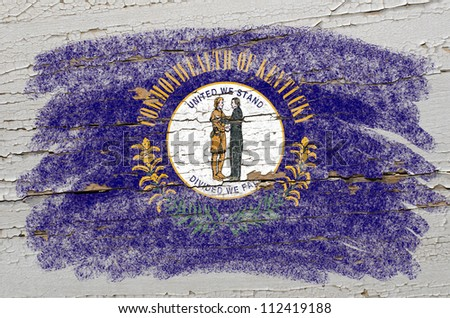 Chalky american state of kentucky flag precisely painted with color chalk on grunge wooden texture - stock photo