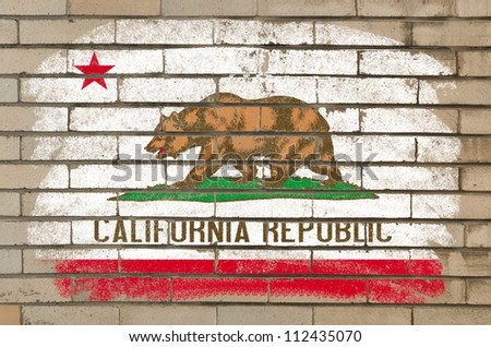 Chalky and grunge american state of california flag painted with color chalk on brick wall - stock photo