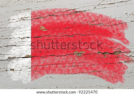 Chalky bahrain flag painted with color chalk on grunge wooden texture - stock photo