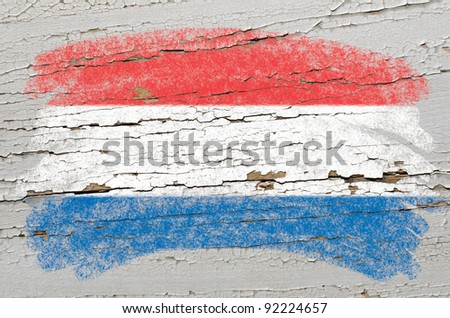 Chalky holland dutch flag painted with color chalk on grunge wooden texture - stock photo