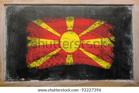 Chalky macedonian flag painted with color chalk on old blackboard - stock photo