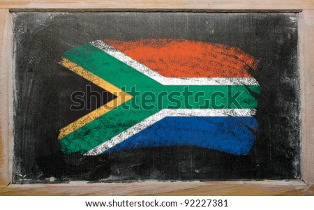 Chalky South african republic flag painted with color chalk on old blackboard - stock photo