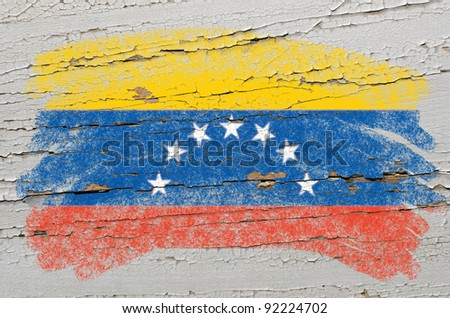 Chalky venezuelan flag painted with color chalk on grunge wooden texture - stock photo