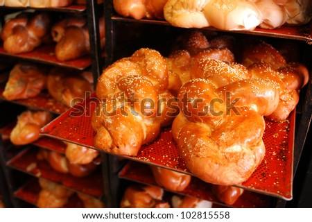 Challah Sabbath bread on display in bakery shop. - stock photo