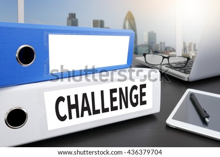 CHALLENGE Office folder on Desktop on table with Office Supplies. - stock photo