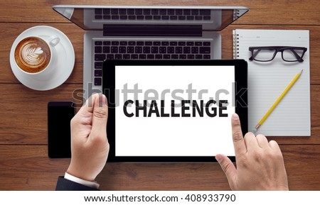 CHALLENGE, on the tablet pc screen held by businessman hands - online, top view - stock photo