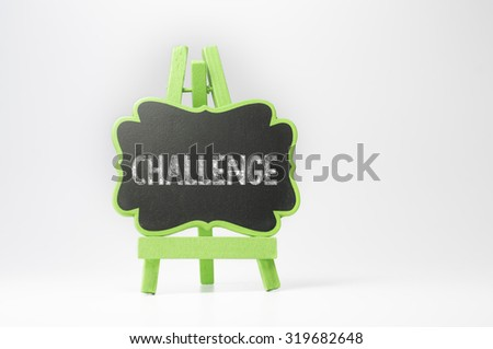 Challenge text on blackboard isolated on white background - stock photo