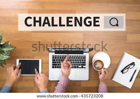 CHALLENGE Two Businessman working at office desk and using a digital touch screen tablet and use computer - stock photo
