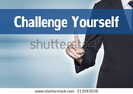 Challenge Yourself Business woman pointing at word for business background concept - stock photo
