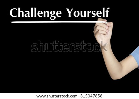 Challenge Yourself Woman writing word with black screen - stock photo