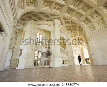 CHAMBORD, FRANCE SEPTEMBER 25, 2011: The spectacular double helix open staircase that is the centerpiece of the castle. The two helices ascend the three floors without ever meeting.   - stock photo