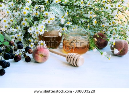 chamomile honey, organic food - stock photo