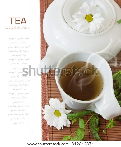Chamomile tea breakfast (still life with tea cup and fresh green leaves isolated on white background with sample text) - stock photo