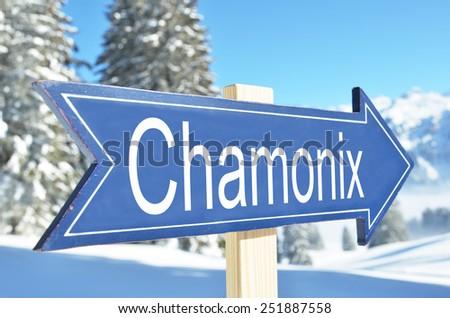 Chamonix arrow against snowy montains - stock photo