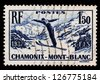 CHAMONIX, FRANCE, CIRCA 1937 - Post stamp printed in France with image of Chamonix mountain skiing and springboard sports center on Chamonix, France, circa 1937 - stock photo