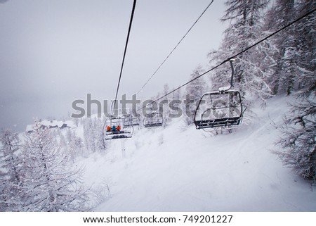 CHAMONIX, FRANCE - January 2015: Chair lift at snowy winter weather in Chamonix, France