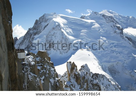 CHAMONIX, FRANCE - OCTOBER 9: Mont-Blanc terrace overlooking Mont Blanc mountain at the mountain top station of the Aiguille du Midi (3842 m) in French Alps on October 9, 2013