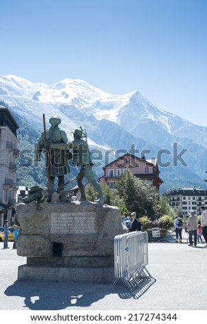 CHAMONIX, FRANCE - SEPTEMBER 02: Bronze statue of H.B. de Saussure. In 1760, the alpine traveller offered a reward to the first person to reach Mont Blanc's summit. September 02, 2014 in Chamonix. - stock photo