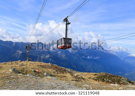 Chamonix, France - September 27, 2015: Cable Car from Chamonix to the summit of the Aiguille du Midi with panoramic view of the mountains and town of Chamonix, France.