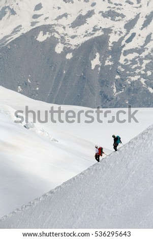 Chamonix Mont Blanc France. July 2015. View of Auguille Du midi observation. People walking on the snow.