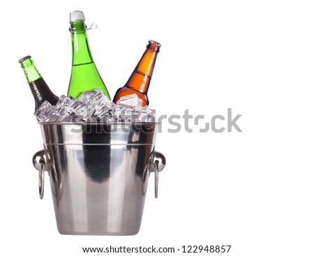 Champagne and beer bottles in ice bucket isolated on a white background