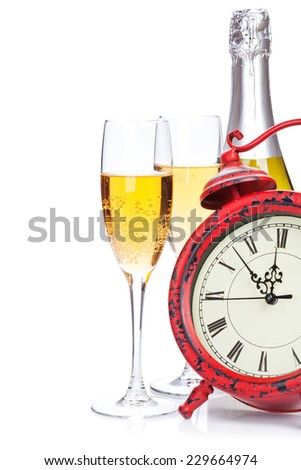 Champagne and christmas clock. Isolated on white background - stock photo