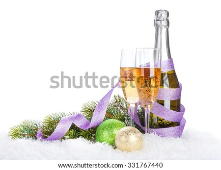 Champagne and christmas decor over snow and fir tree with copy space - stock photo