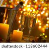 Champagne and Christmas Lights - stock photo