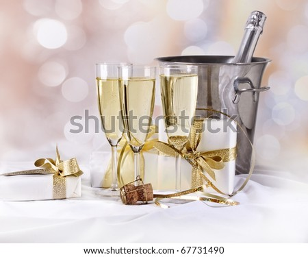 Champagne and gifts - stock photo