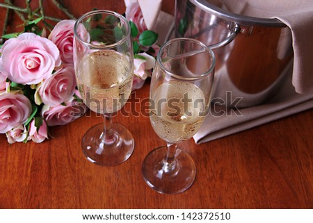 Champagne and glasses on round table close-up - stock photo