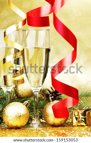 Champagne and new year decoration on golden background