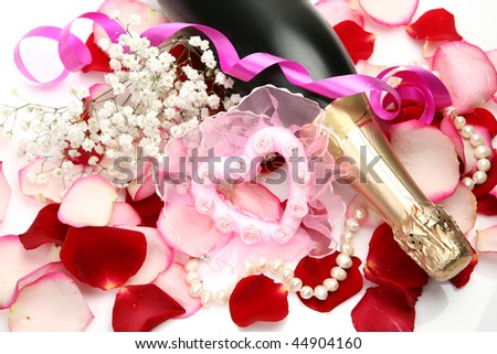 Champagne and petals of roses