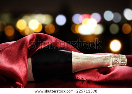 champagne and red napkin  - stock photo