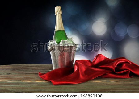 champagne and red satin  - stock photo