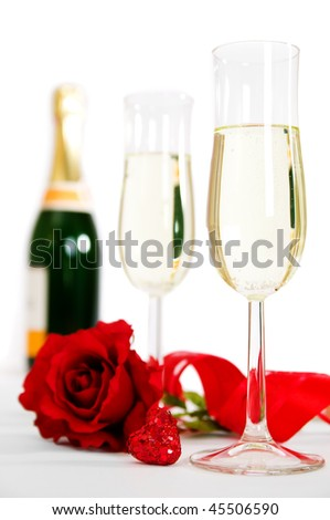 Champagne and roses for celebration of Valentines day with bottle in background