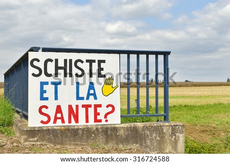 CHAMPAGNE-ARDENNE, FRANCE, JULY 15: Local poster against research of gaz de schiste or shale gas in Champagne-Ardenne region of France. The technology of production is dangerous for environment - stock photo