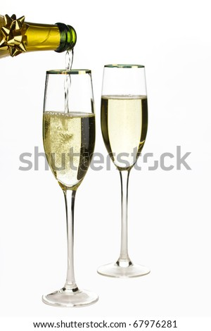 Champagne being poured into glass, isolated on a white background