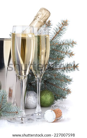 Champagne, blue firtree and christmas decor. Isolated on white background - stock photo