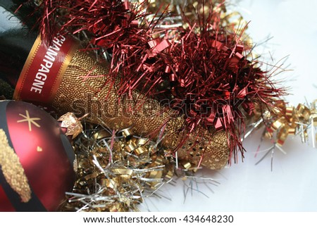 Champagne bottle and christmas decorations - stock photo